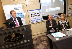 NO REPRO FEE 26/10/2016 Pictured are Taoiseach Enda Kenny TD with Mairead Fernane, Founder and National President of Victim Assistance Ireland, and Michael Bennett, Chairman of the Federation for Victim Assistance, at the launch of the Federation for Victim Assistance's freephone number 1 800 277477 today at Buswells Hotel, Dublin. The services, which are strictly confidential, include a call back telephone service, face to face meetings, always attended by two members, court accompaniment, onward referral - only with your permission, information on victim impact statements, assistance with forms including criminal Injuries compensation and information on the workings of the Criminal Justice System. The Federation for Victim Assistance is a voluntary organisation structured in County and District Branches around the country. All branches are governed by the constitution of the Federation for Victim Assistance. Their Volunteers are the lifeblood of the organisation and all are fully trained and Garda-Vetted. They offer emotional and practical assistance to all Victims of Crime and Traumatic incidents. The service is also available to Victims' family members. While they do not provide financial assistance the service is free and confidential. PHOTO: Mark Stedman